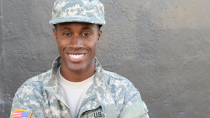 man in military uniform smiling
